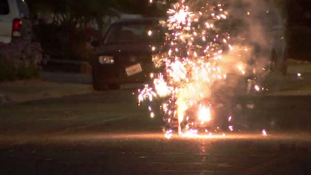 A man sets off an illegal firework in San Jose, Calif. on July 4, 2018.