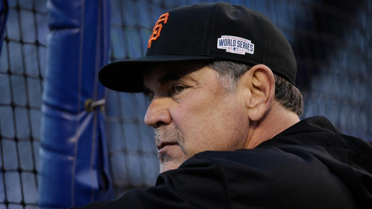 San Francisco Giants manager Bruce Bochy watches his team during batting practice before Game 6 of baseballs World Series between the Kansas City Royals.