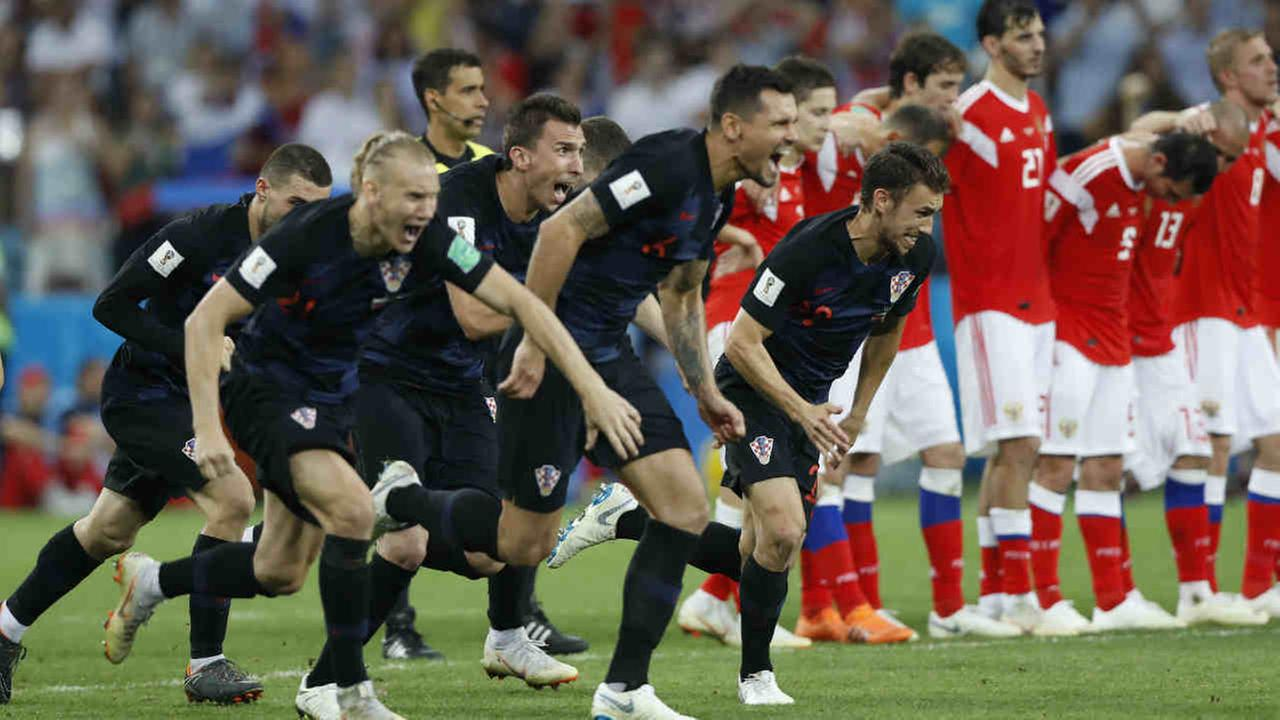 Croatia players celebrate at the end the match between Russia and Croatia at the 2018 soccer World Cup in the Fisht Stadium, in Sochi, Russia, Saturday, July 7, 2018.