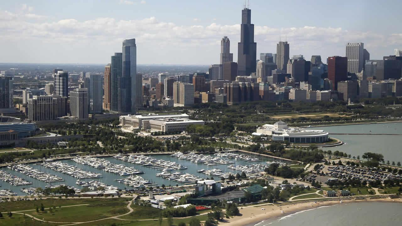 The Chicago skyline is seen from the media helicopter traveling with President Barack Obama to the landing zone, Saturday, Aug. 11, 2012, in Chicago. (AP Photo/Carolyn Kaster)