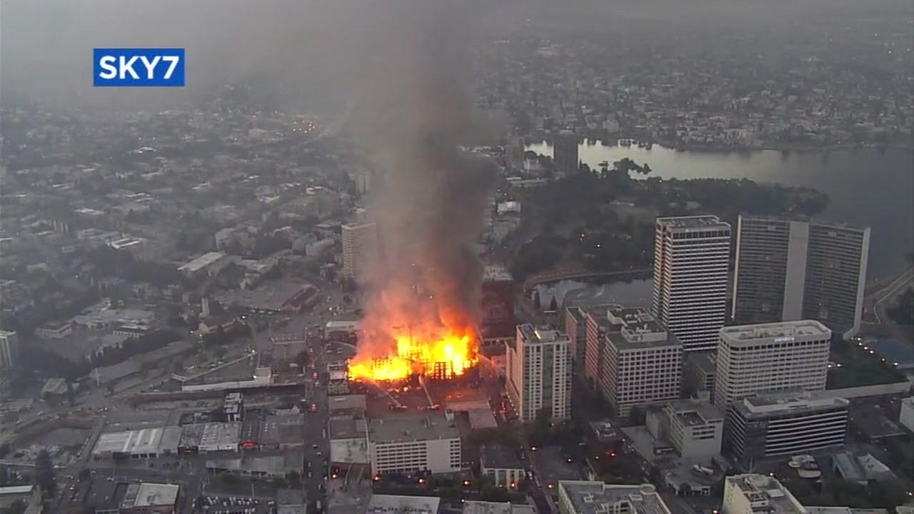 A fire believed to have been caused by arson is pictured in Oakland, Calif.
