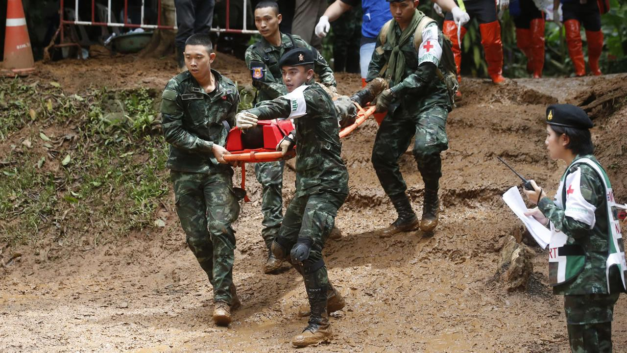 Thai soldiers hold an evacuation drill near the Tham Luang Nang Non cave in Mae Sai, Chiang Rai province, in northern Thailand Saturday, June 30, 2018.