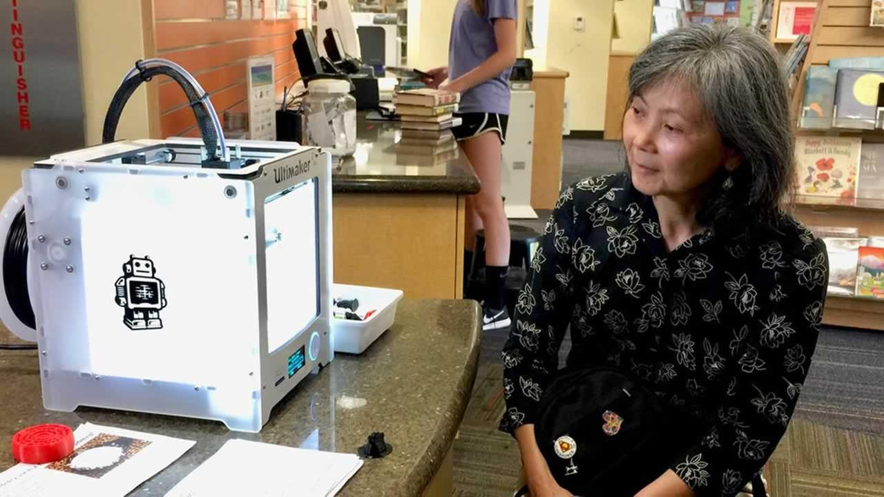 Pauline Lau Broyles waits while a 3D printer makes a new penguin to add to her collection in San Carlos, Calif. on Thursday, July 12, 2018.