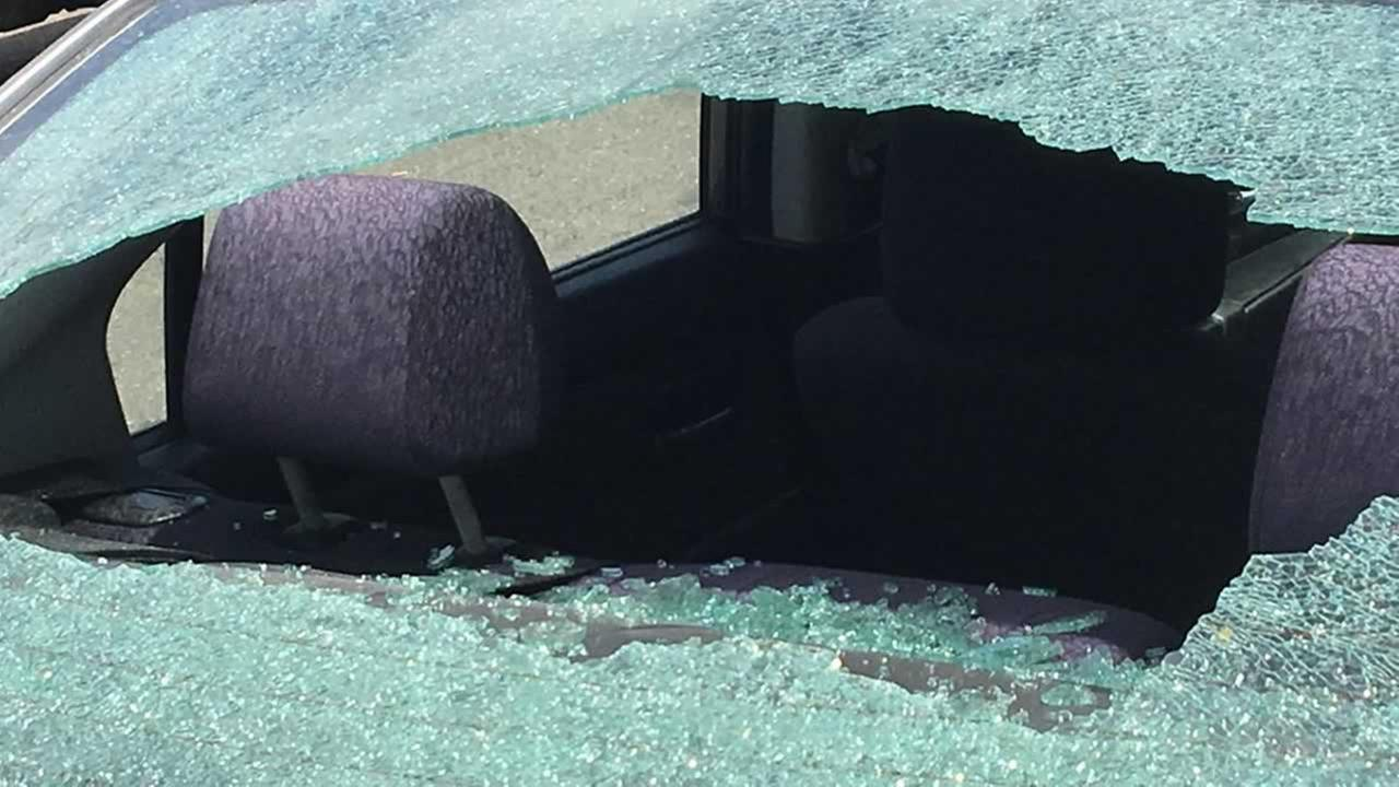 The window of this car was shattered during a shooting incident in Oakland, Calif. on Wednesday, July 11, 2018 that left a 3-year-old boy injured by shrapnel.