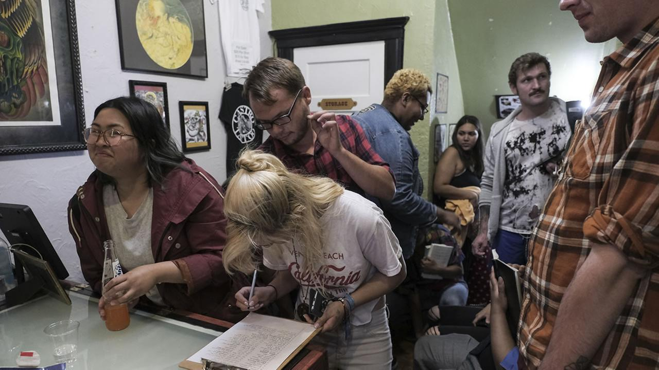 Customers are seen at Castro Tattoo in San Francisco on Friday, 13, 2018.