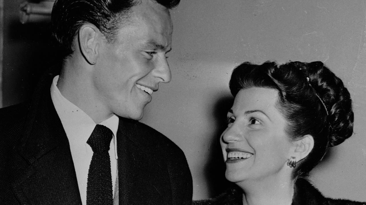 Singer Frank Sinatra and his wife Nancy smile broadly as they leave a Hollywood night club, Oct. 23, 1946, following a surprise meeting.