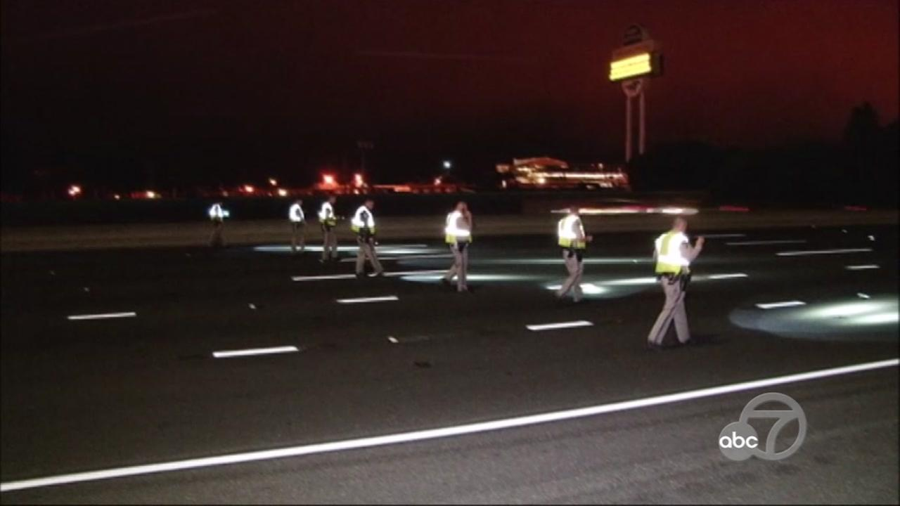 CHP officers are seen sweeping lanes of I-80 for evidence in Berkeley, Calif. on Saturday, July 14, 2018.