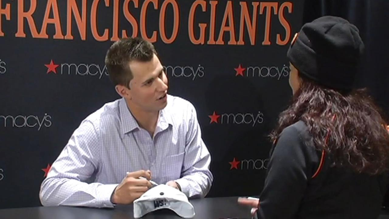 San Francisco Giants second baseman Joe Panik signed autographs for fans at Macys Union Square on Saturday, one day after the World Series Victory parade.