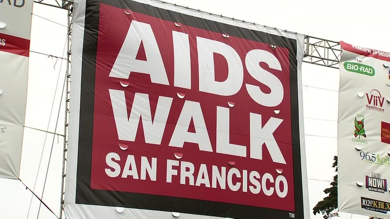 A sign reading AIDS Walk San Francisco is hung in Golden Gate Park on Sunday, July 15, 2018.