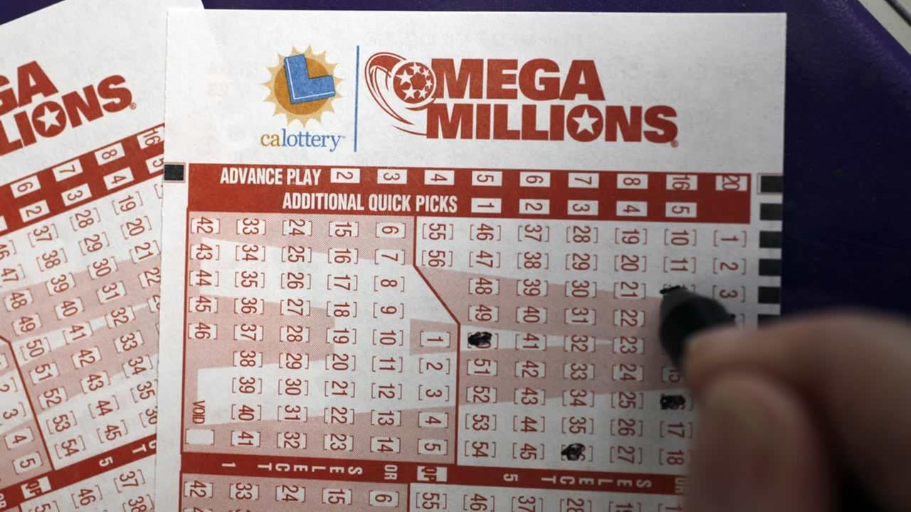 A customer fills out a lottery ticket in Palo Alto, Calif., March 30, 2012. (AP Photo/Paul Sakuma)