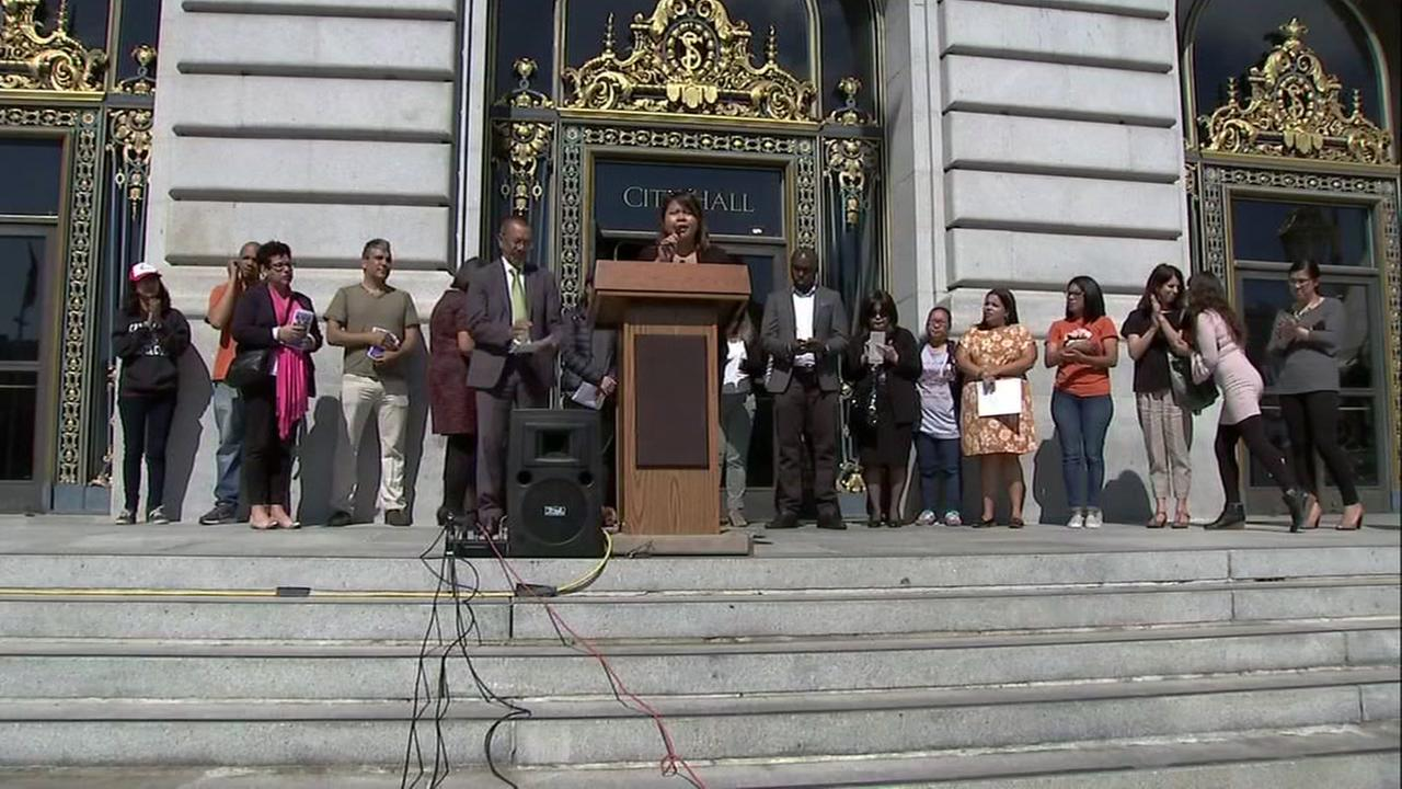 Officials gather at San Francisco City Hall for a press conference on allowing non-citizens to vote on Monday, July 16, 2018.