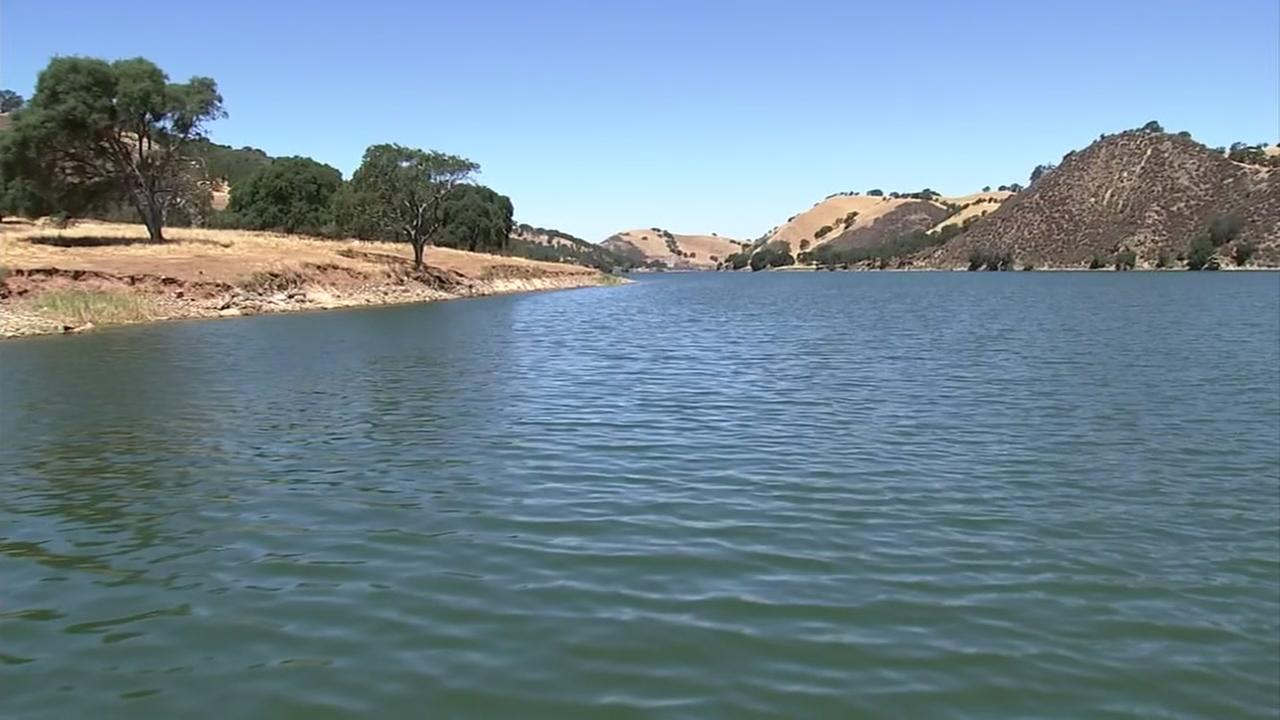 A boat glides through the Del Valle Reservoir in Livermore, Calif. on Monday, July 16, 2018.