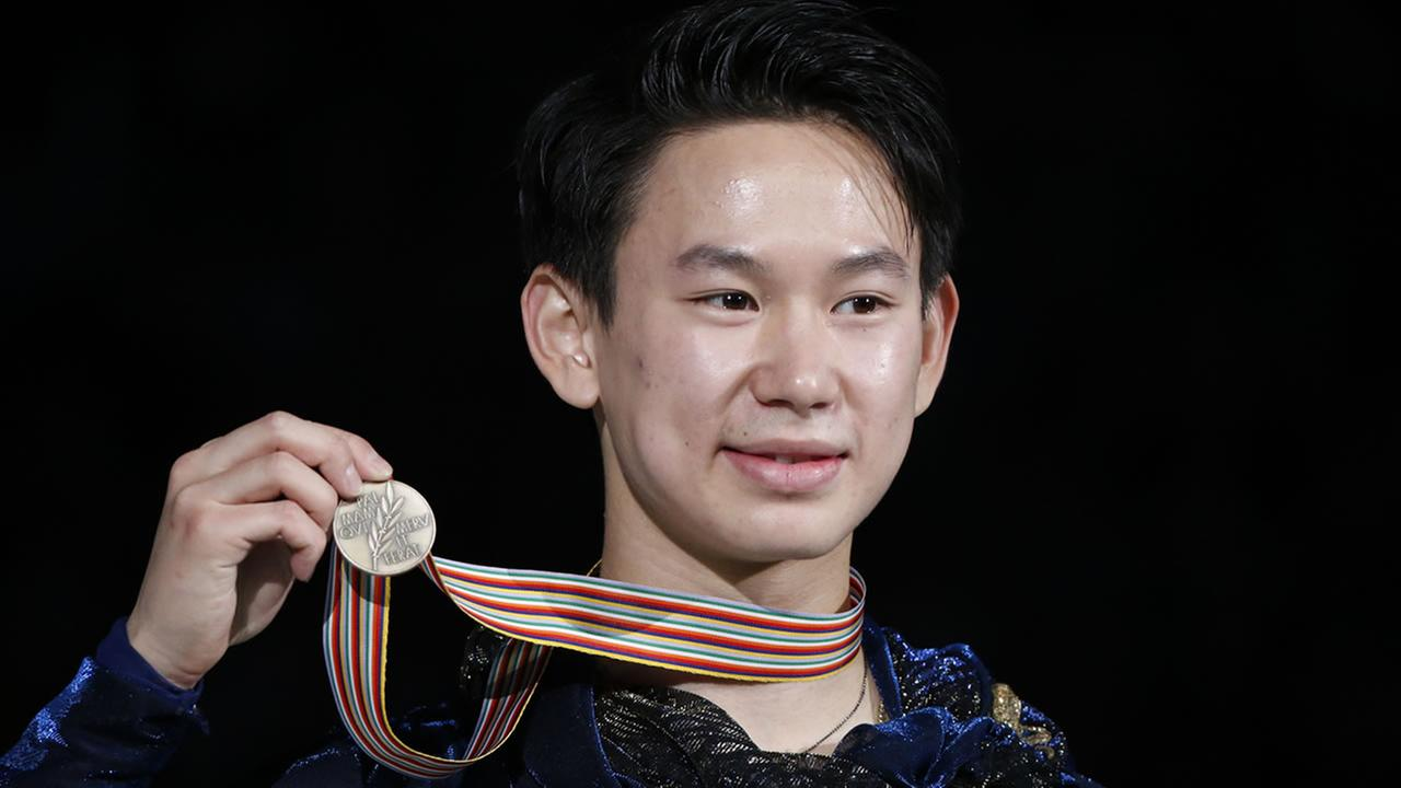 Denis Ten of Kazakstan displays his bronze medal from the Men Free Skating event in the ISU World Figure Skating Championship 2015 in Shanghai, China March 28, 2015.