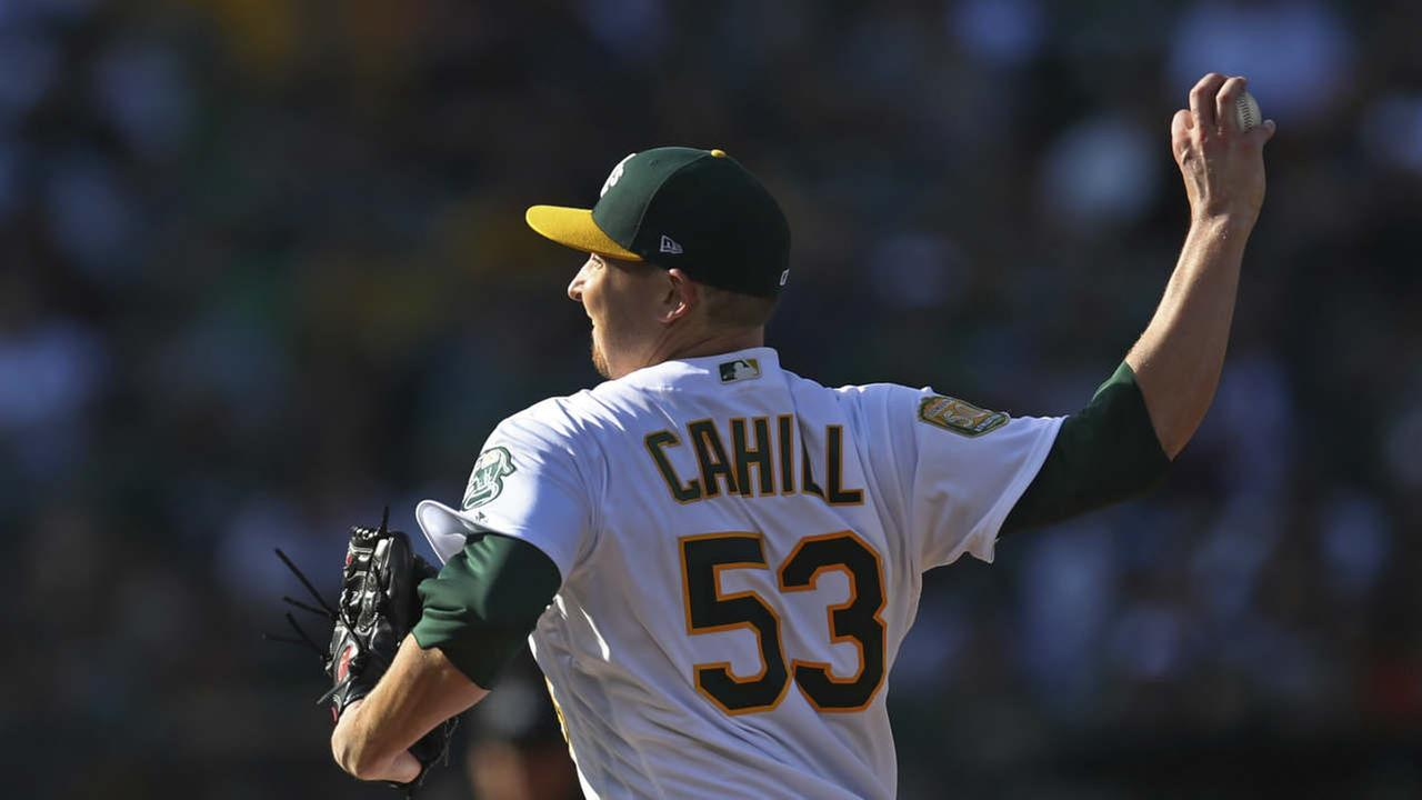 Oakland Athletics pitcher Trevor Cahill works against the San Francisco Giants during the first inning of a baseball game Saturday, July 21, 2018, in Oakland, Calif.