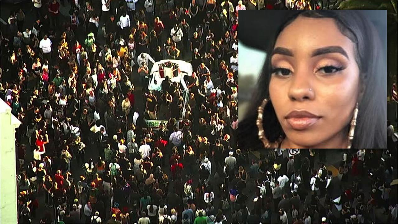 A crowd gathers in downtown Oakland on Monday, July 23, 2018. to mourn 18-year-old Nia Wilson (pictured on right) who was tragically killed at MacArthur BART station.