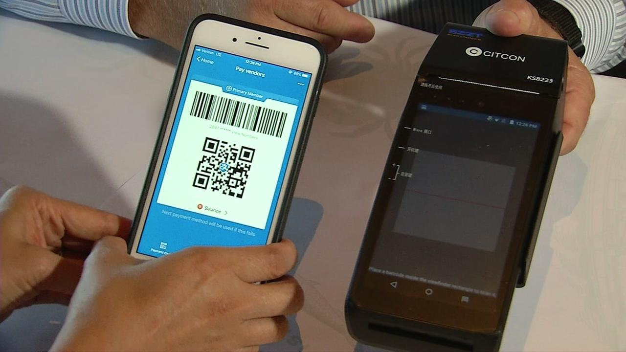 Alipay is demonstrated at a restaurant in San Francisco on Wednesday, July 25, 2018.