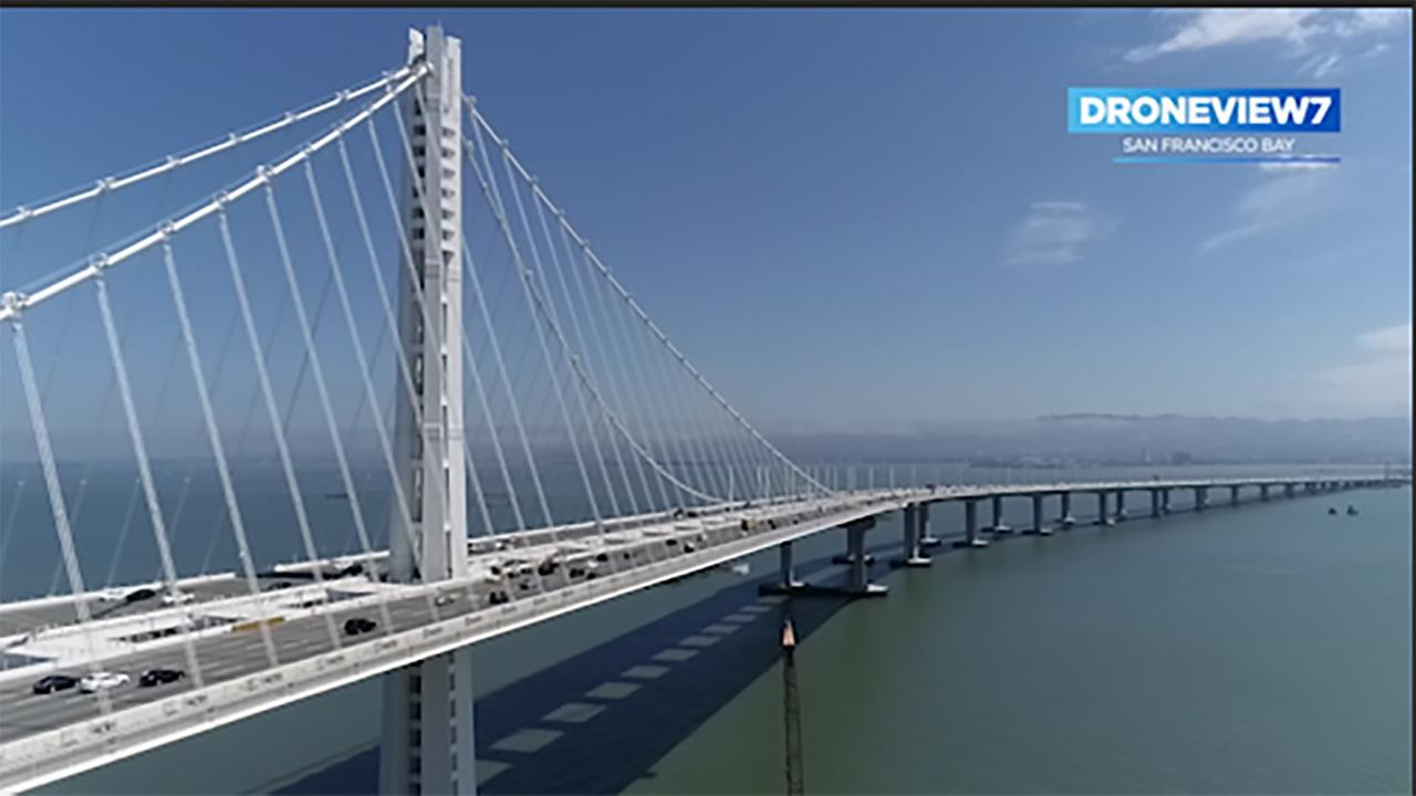 The new Bay Bridge connects Oakland to San Francisco, some of the piers from the former bridge remain.