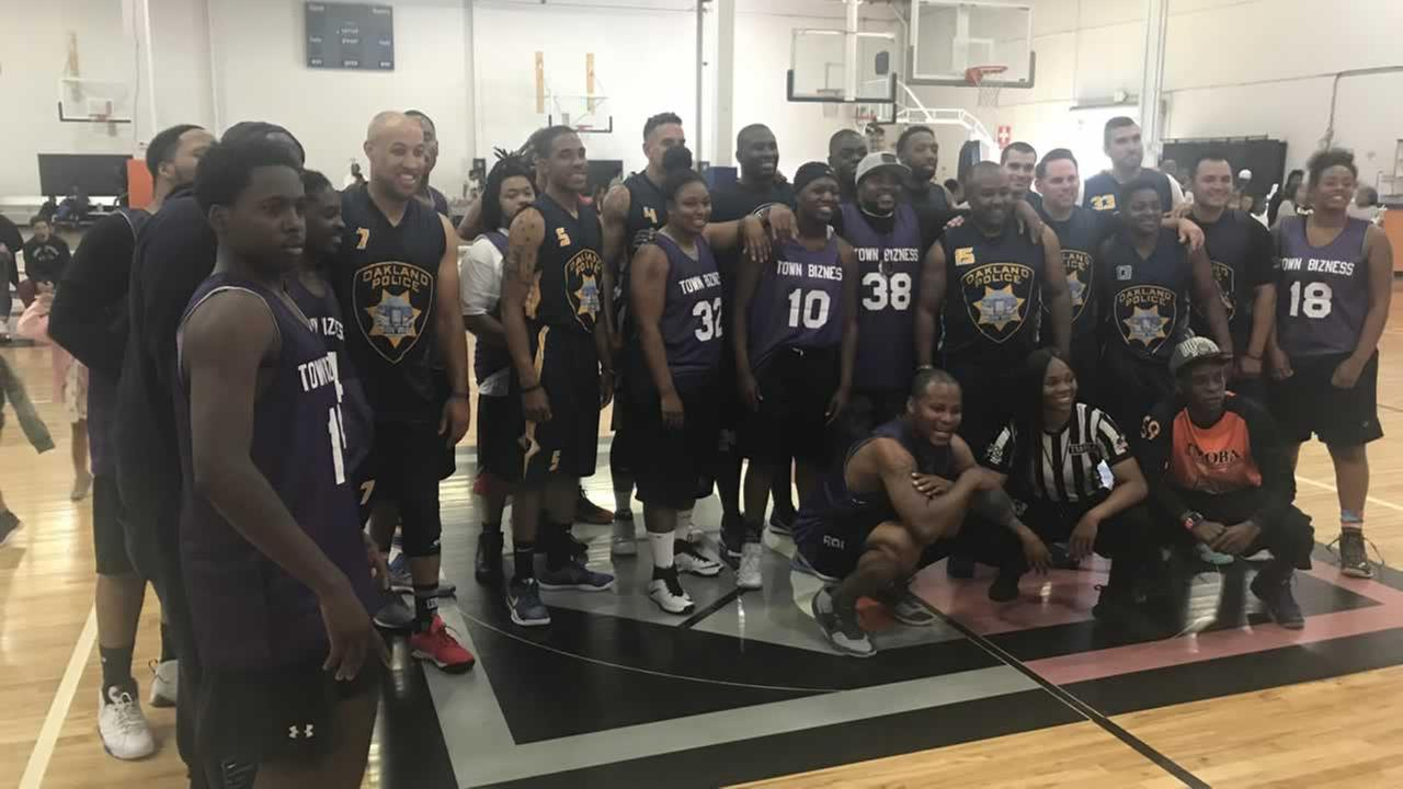 Oakland police and team Town Bizness pose together after a community basketball game on Sunday, July 29, 2018.