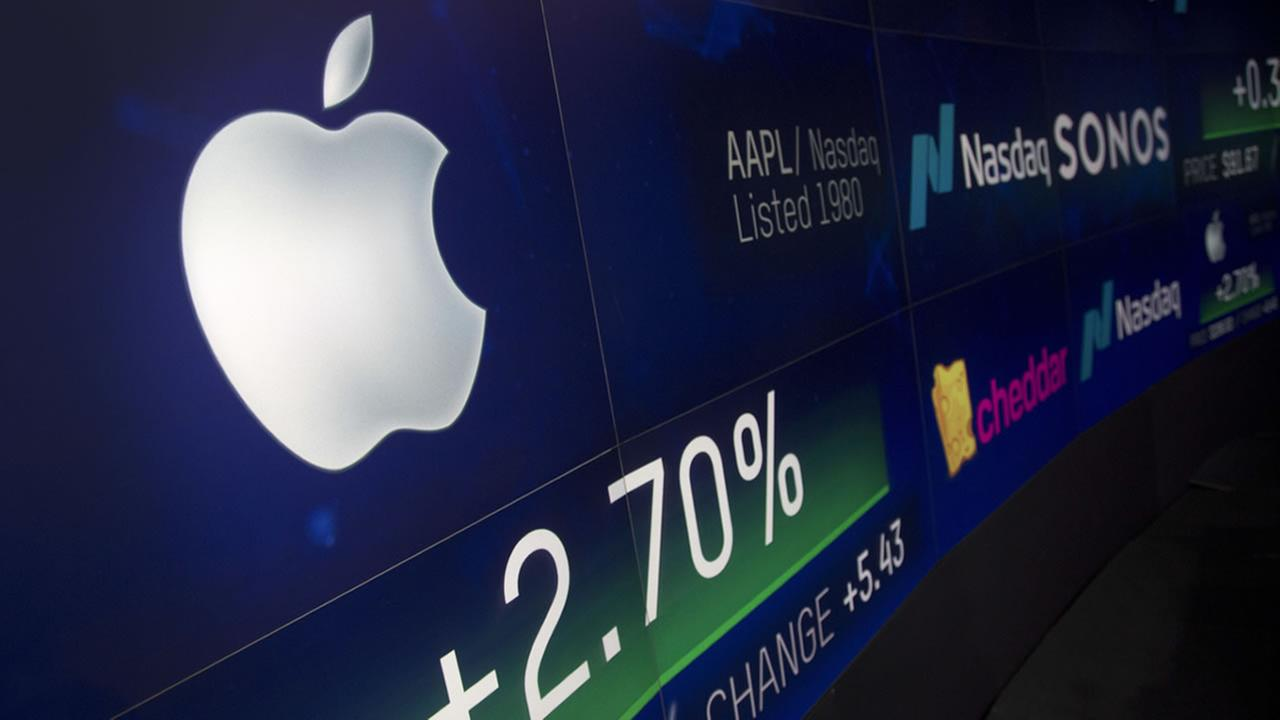 An electronic screen displays Apple stock at the Nasdaq MarketSite, Thursday, Aug. 2, 2018, in New York.