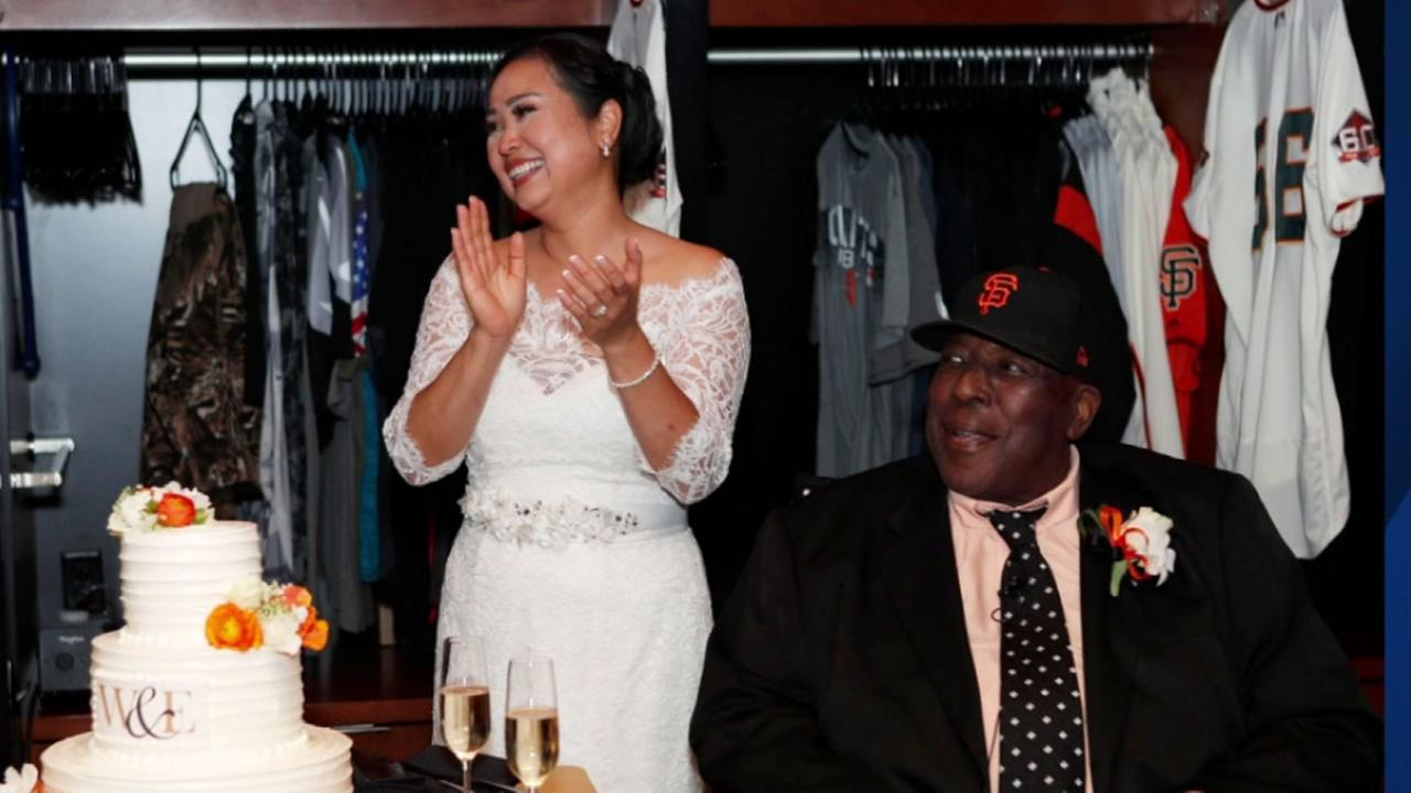 Willie McCovey and his bride Estela appear in the San Francisco Giants locker room on Thursday, Aug. 2, 2018.