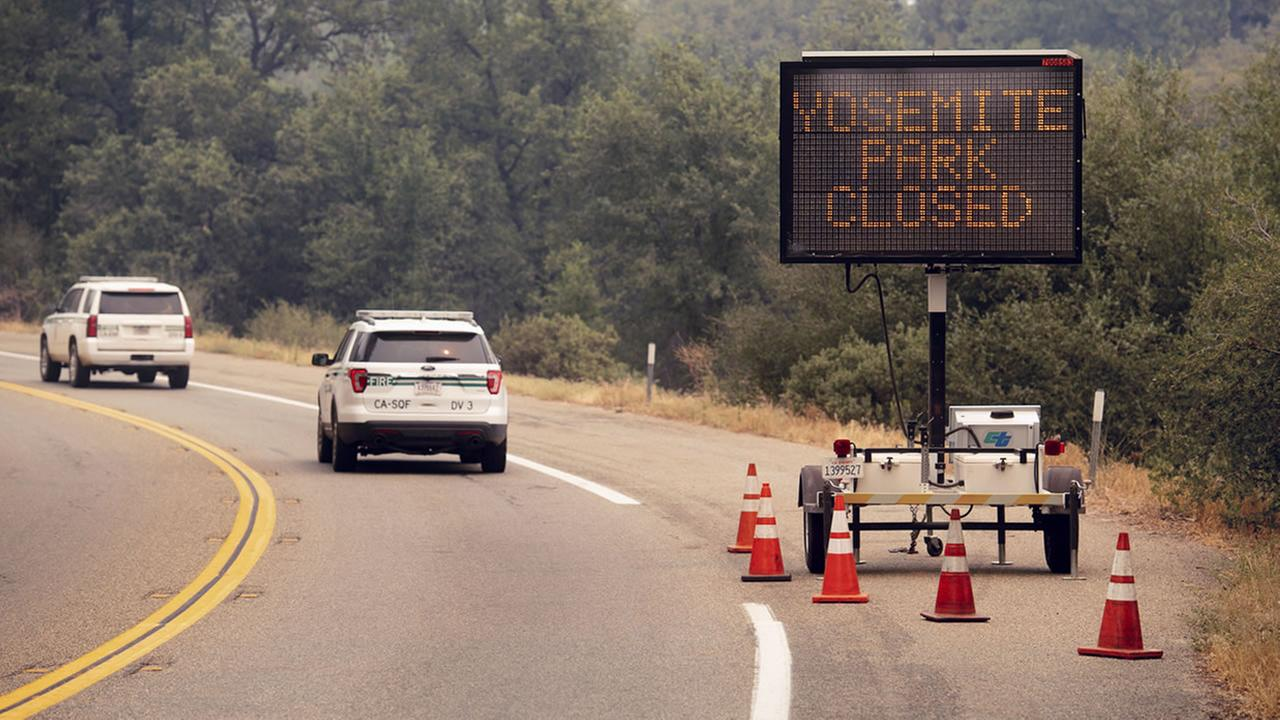 A sign on Highway 41 announces the closure of Yosemite National Park near Oakhurst, Calif., on Wednesday, July 25, 2018.