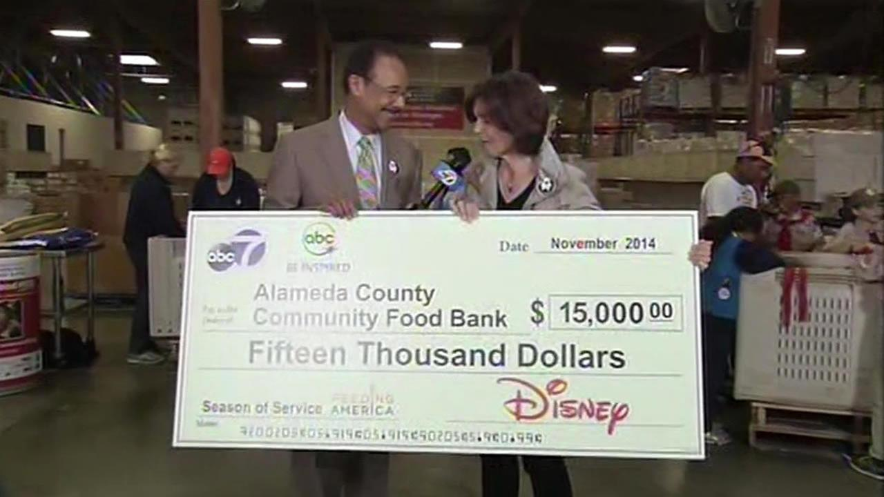 Spencer Christian presents a check for $15,000 to Alameda County Community Food Bank on behalf of ABC7 and our parent company Disney.
