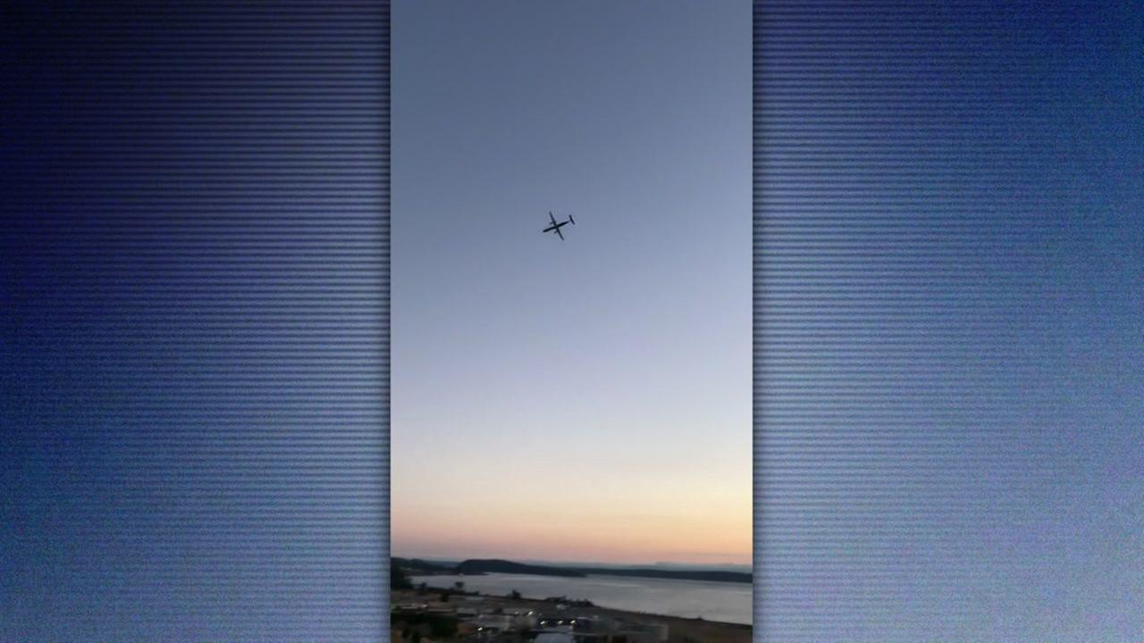 A plane stolen from Seattle-Tacoma International Airport is seen in the air on Aug. 10, 2018.
