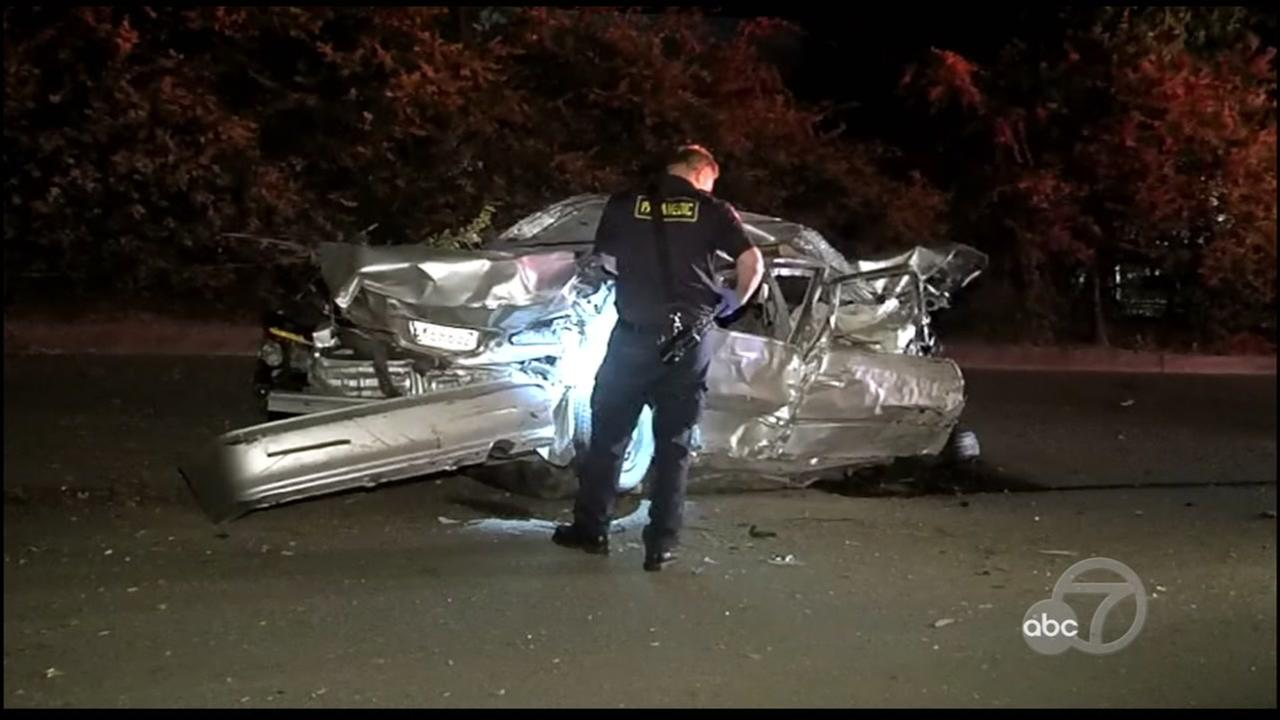 A police officer is seen after a deadly crash in Walnut Creek, Calif. on Sunday, August 12, 2018.