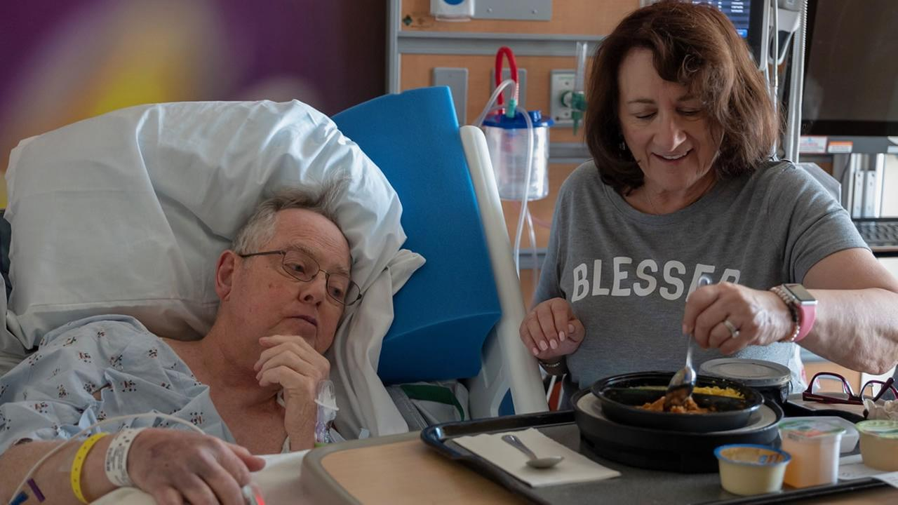 Penny Halvorsen feeds Bill Halvorsen in a Redwood City, Calif. hospital on Monday, Aug. 13, 2018.