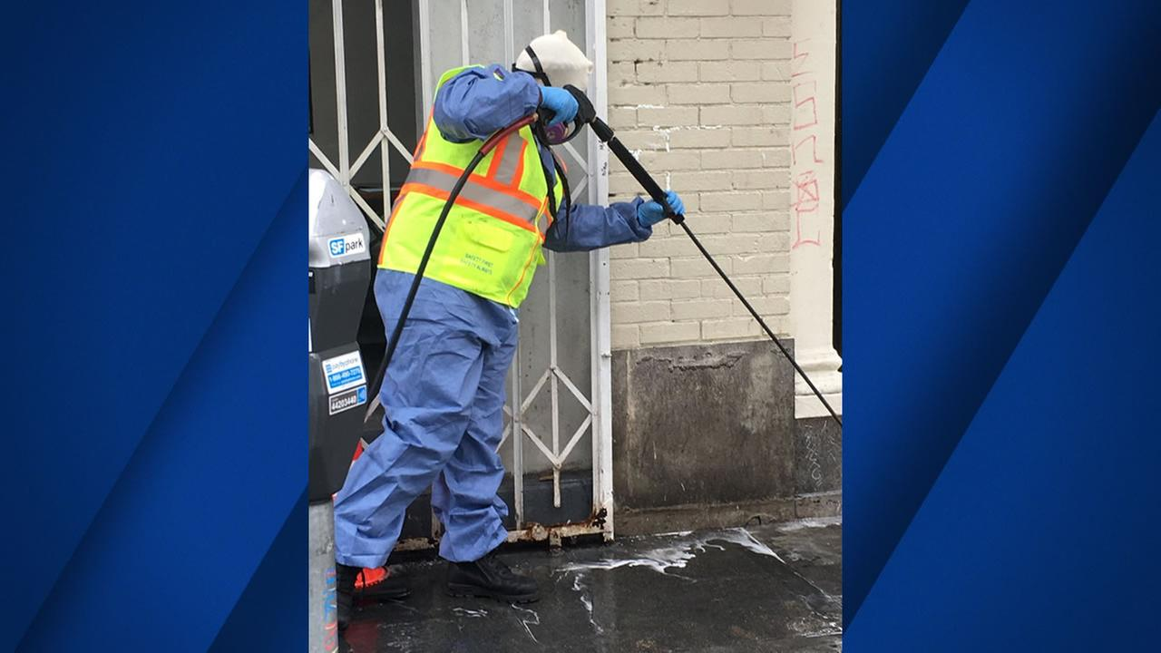 A worker cleans off San Francisco city streets in this photo taken on Tuesday, August 14, 2018.