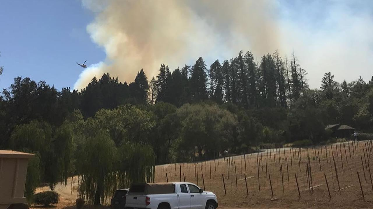 This photo was taken of a fire threatening homes in Healdsburg, Calif. on Thursday, August 16, 2018.