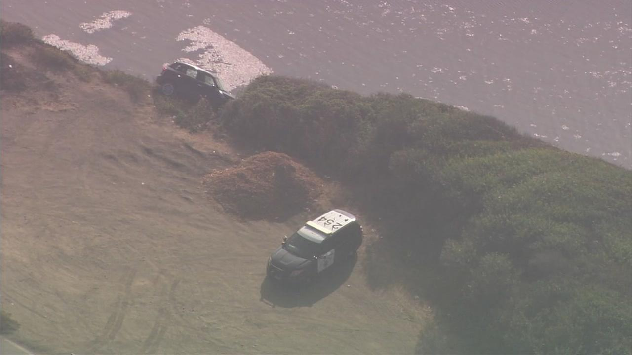 A car teeters on the end of a cliff along the San Mateo County Coast near Half Moon Bay, Calif. on Friday, August 17, 2018.