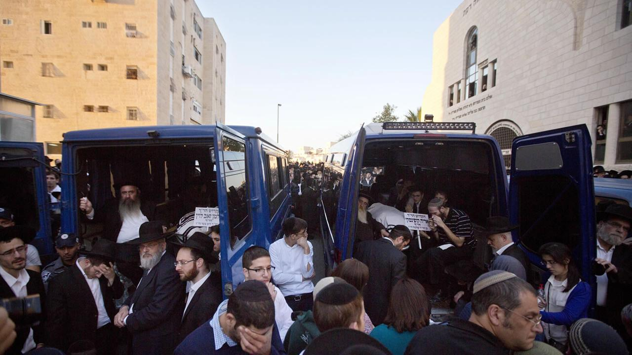 Israelis and relatives attend the funerals of Aryeh Kupinsky, Cary William Levine, and Avraham Goldberg, three of the four people killed in a shooting attack in a synagogue.
