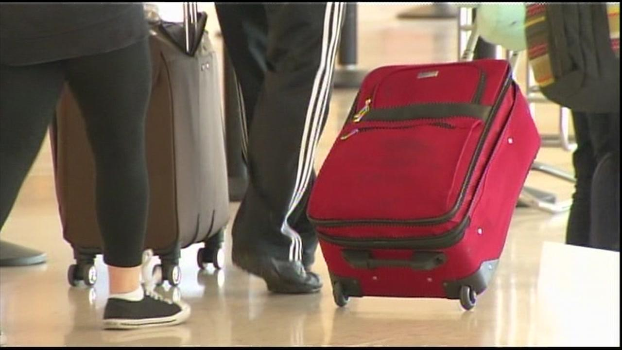 A suitcase is wheeled through San Francisco International Airport in this undated file photo.