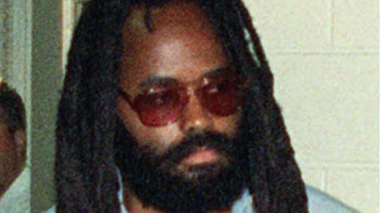 Death row inmate Mumia Abu-Jamal, is lead to court in Philadelphias City Hall, on July 14, 1995. (AP Photo/POOL, Steven M. Falk)