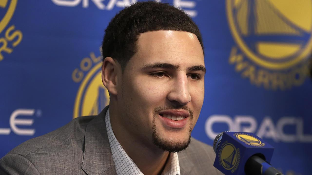 Golden State Warriors Klay Thompson, left, speaks during a news conference on Nov. 1, 2014, in Oakland, Calif. (AP Photo/Ben Margot)