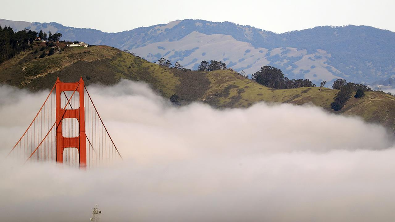 A tower from the Golden Gate Bridge in San Francisco rises over a blanket of fog on Jan. 13, 2017.