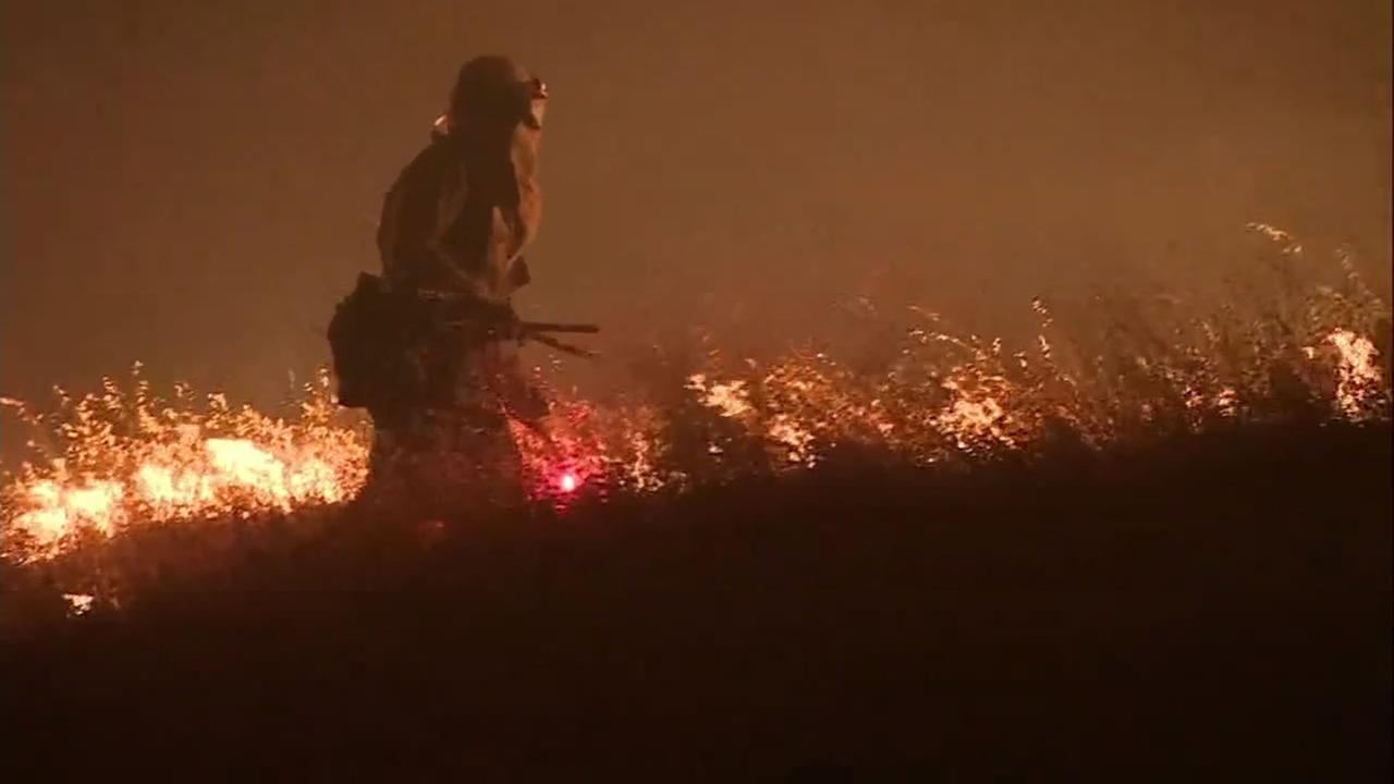 A firefighter battles the Complex fires in Mendocino County, Calif.