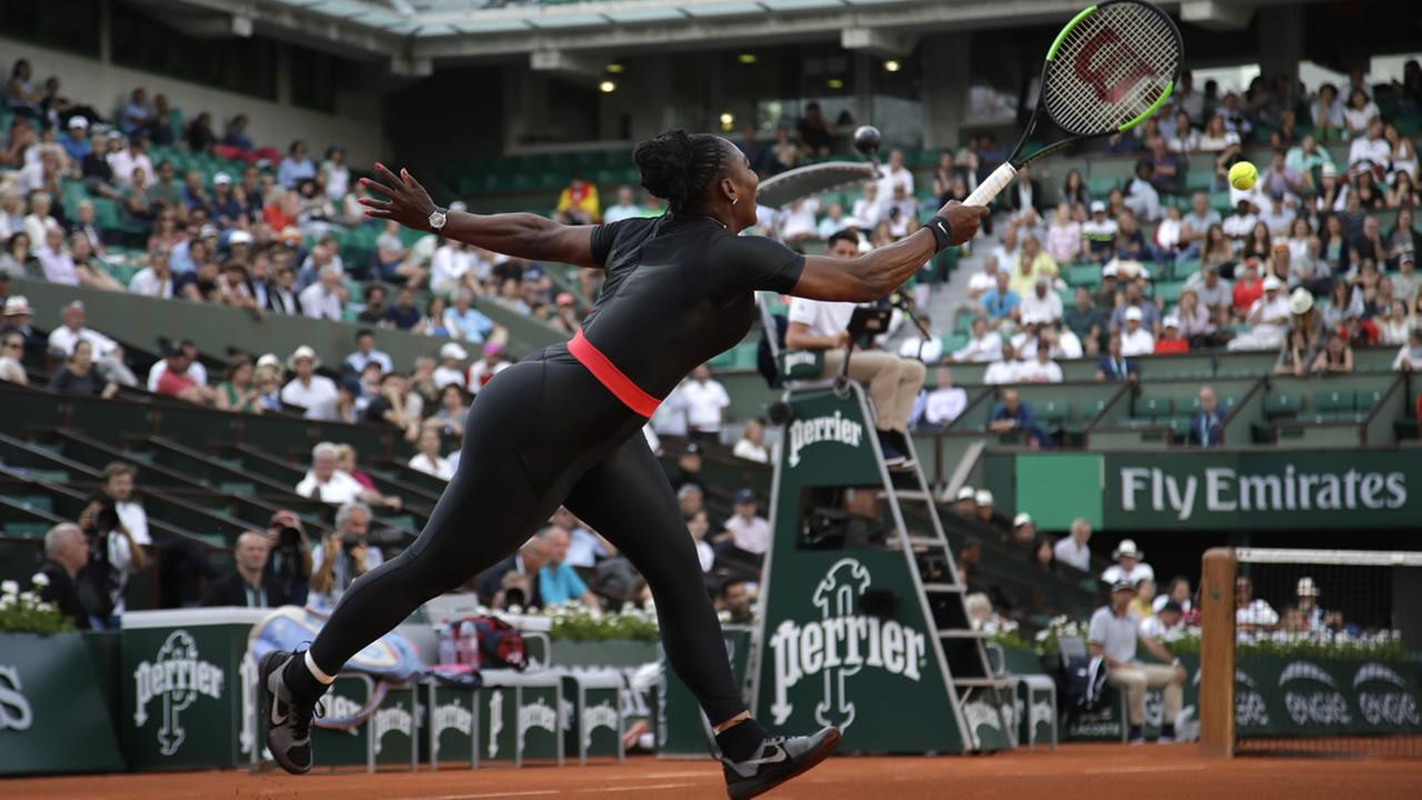 Serena Williams of the U.S. returns the ball to Australias Ashleigh Barty during their second round match of the French Open tennis tournament  Thursday, May 31, 2018 in Paris.