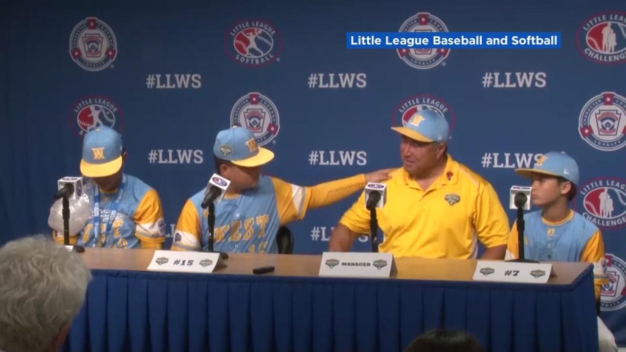 A Hawaiian Little League player comforts his coach in a touching moment during an interview on Friday, August 24, 2018.