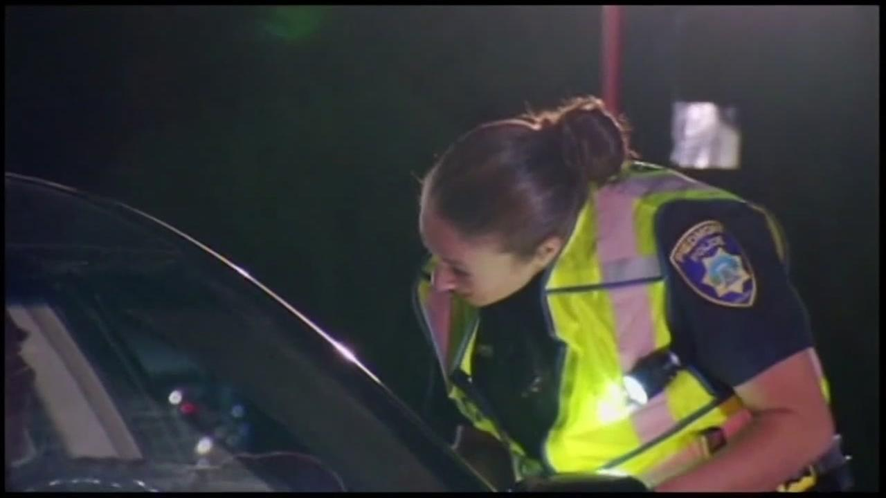 A police officer speaks to a driver she pulled over in this undated file photo.