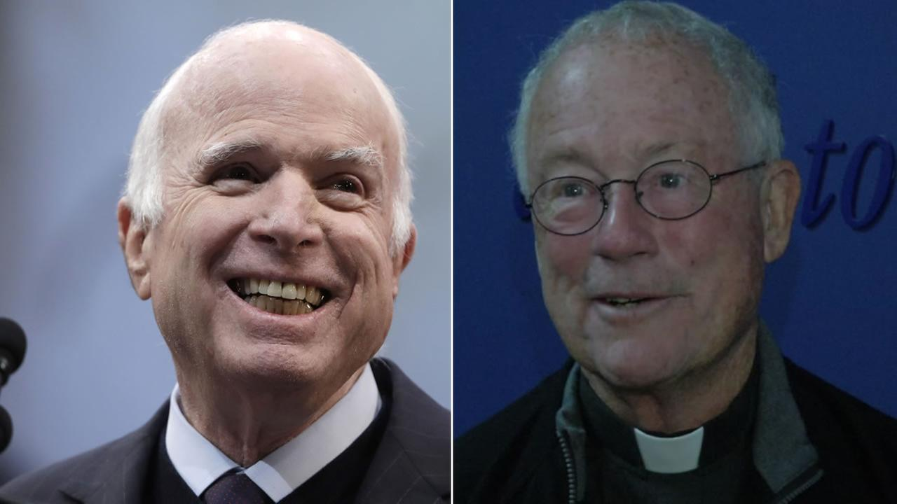 Sen. John McCain, left, is pictured next to Father Edward A. Reese, right.