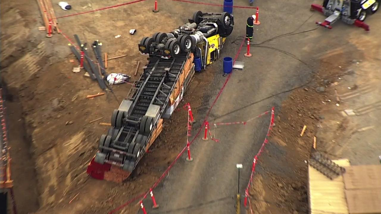 A truck is seen after flipping over at a construction site in Menlo Park, Calif. on Tuesday, August 28, 2018.
