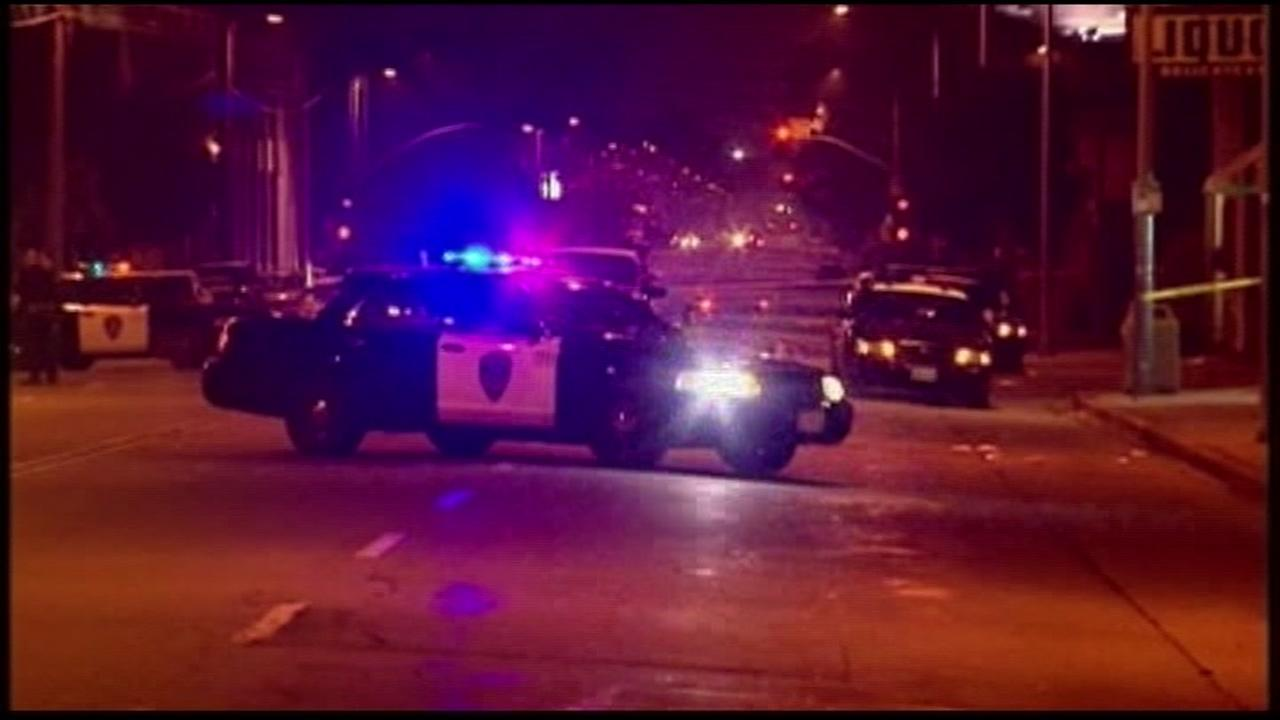 A police cruiser blocks the road in Oakland, Calif.