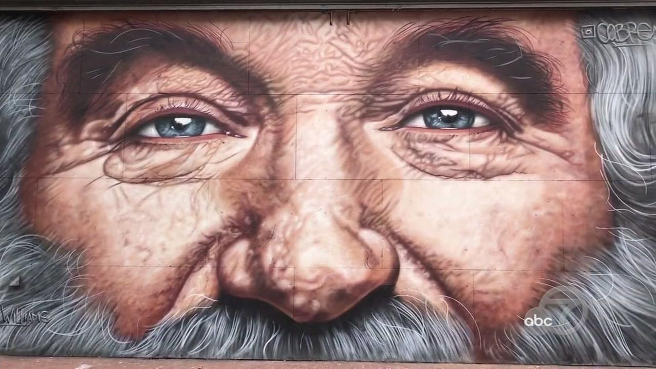 The eyes of Robin Williams stare onto Market Street in San Francisco on Tuesday, Aug. 28, 2018.
