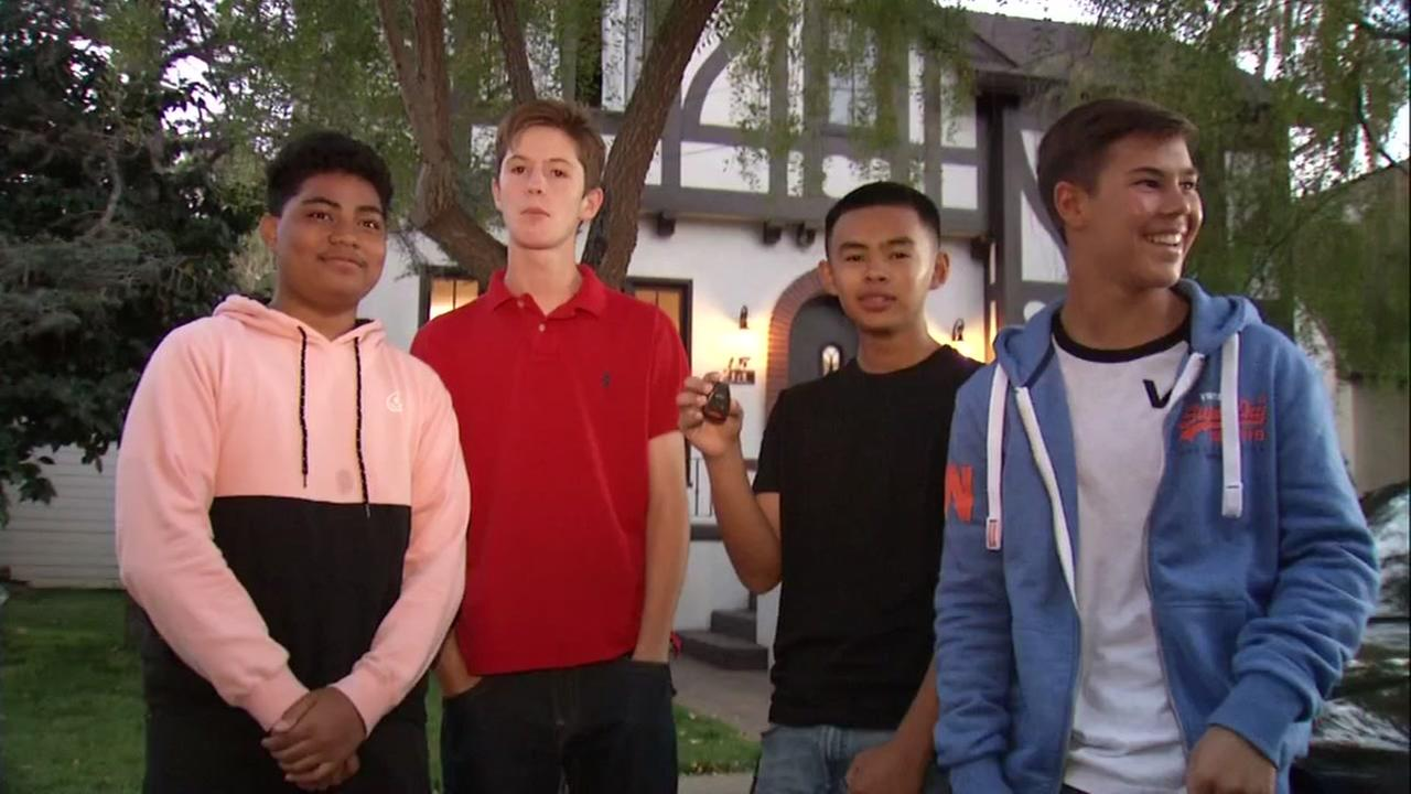 A group of four teens show off the keys to their new car after winning it in a San Leandro, Calif. scavenger hunt on Tuesday, Aug. 28, 2018.