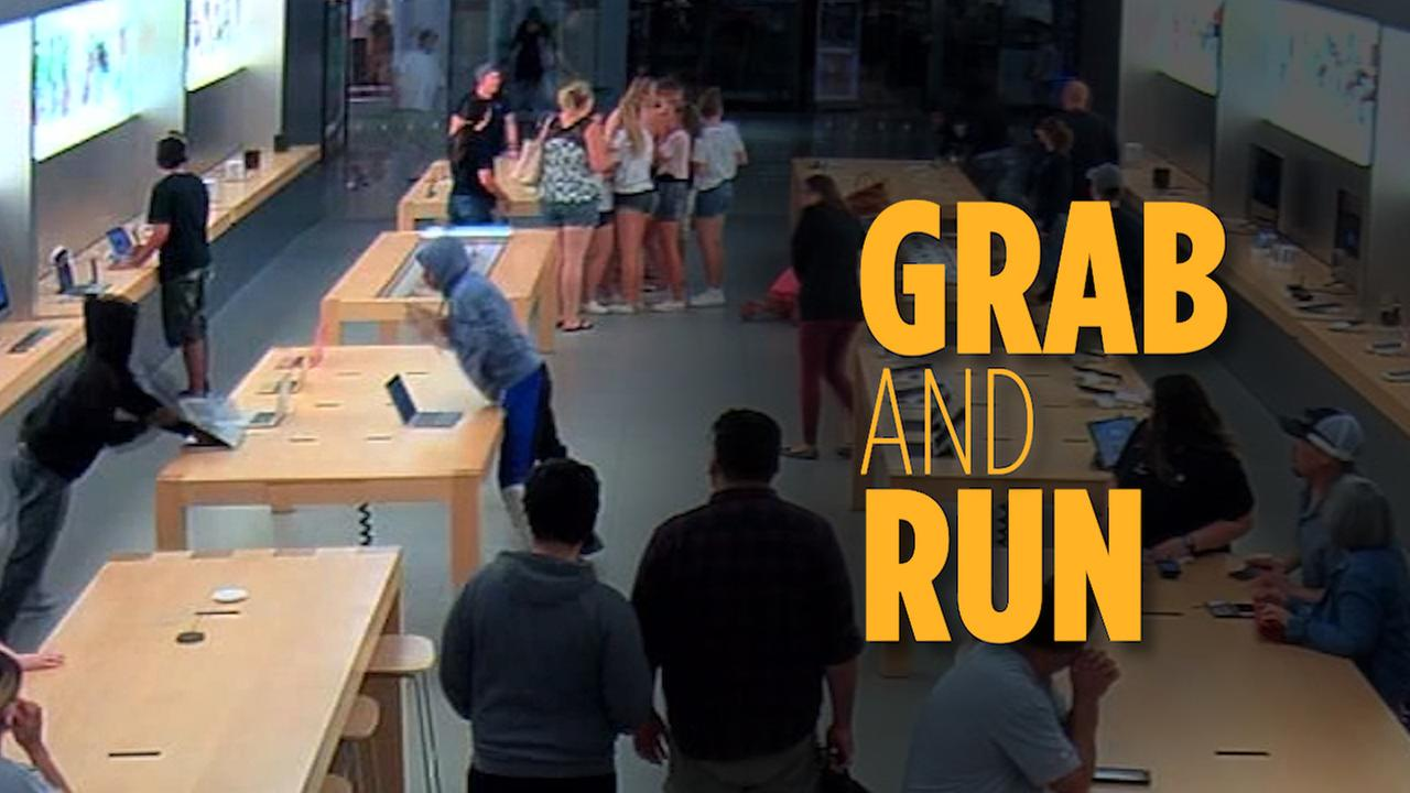 Thieves grab merchandise at the Apple store in Fashion Fair Mall in Fresno, Calif. on July 7, 2018.