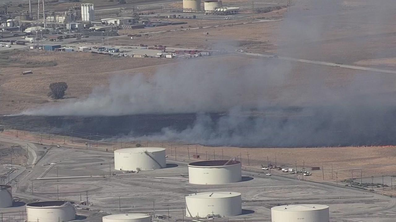 A grass fire is burning at the Tesoro Refinery in Contra Costa County on Friday, August 31, 2018.
