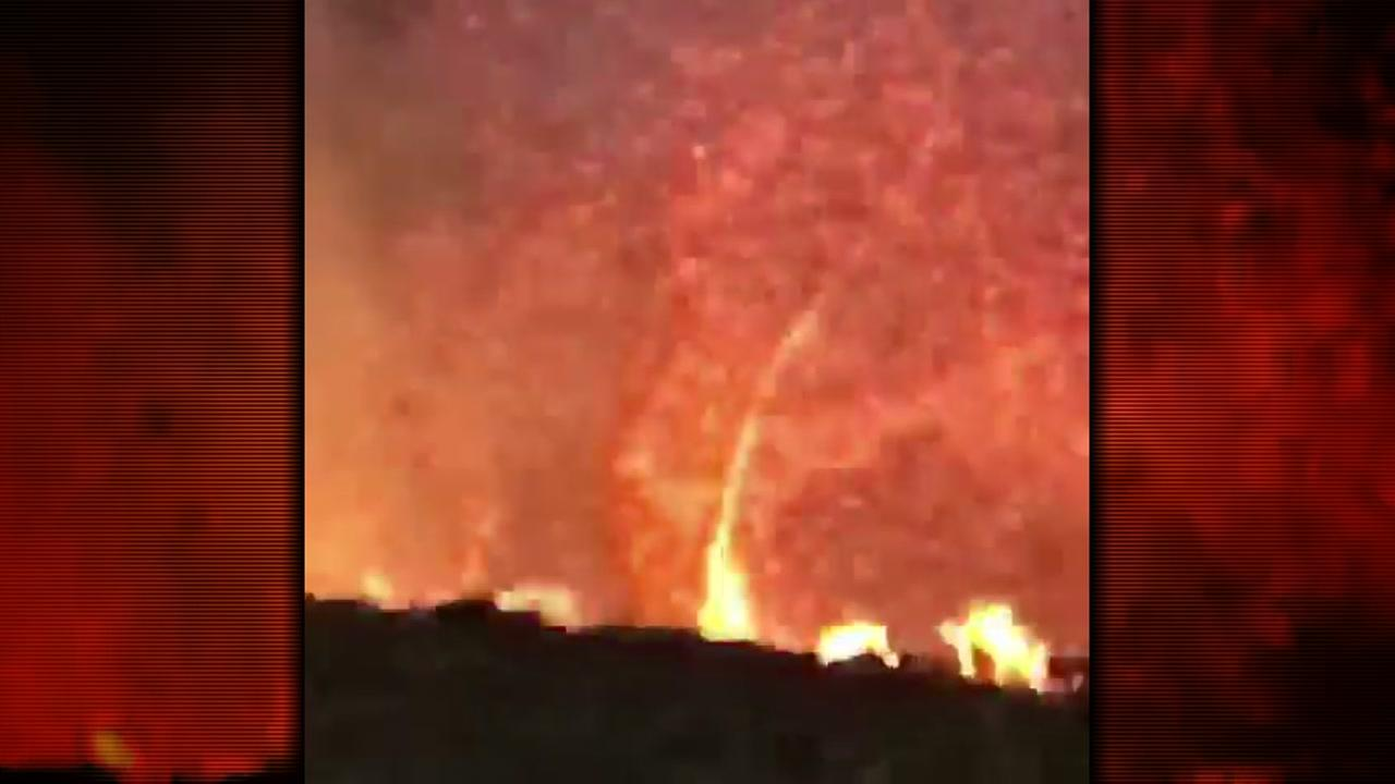 A firefighter battling the Carr Fire in the Redding area captured video of a fire whirl.