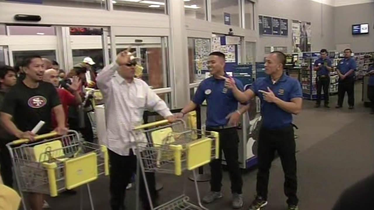 Shoppers rush into Best Buy in Colma on Thanksgiving.